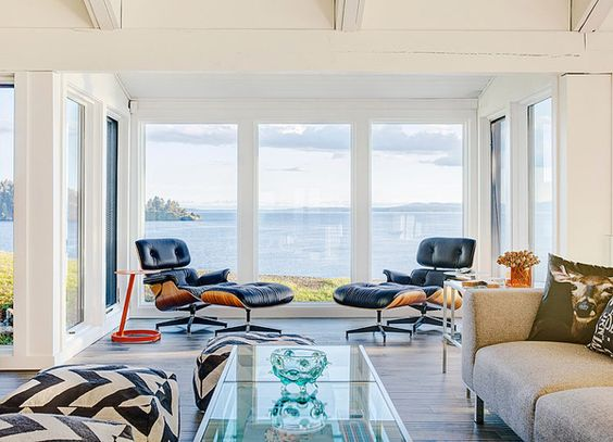 The floor to ceiling windows are to die for..I would love to chill in those leather recliner chairs and day dream...and it would also be a breathtaking place to a watch summer storm!