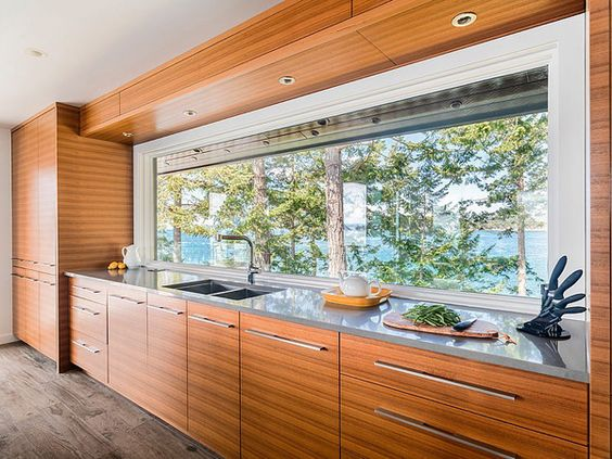 This huge window over the kitchen counter is incredible...and the view is so impressive. Besides the view, the teak cabinets steel the show in this kitchen, really beautiful.
