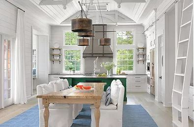 An open-flowing kitchen which combines the kitchen, dining area and breakfast nook..perfection for a summer vacation home..it is all about family time.