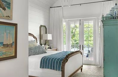 This bedroom reminds me of a darling bedroom you would find in a Captain of a boat's home.