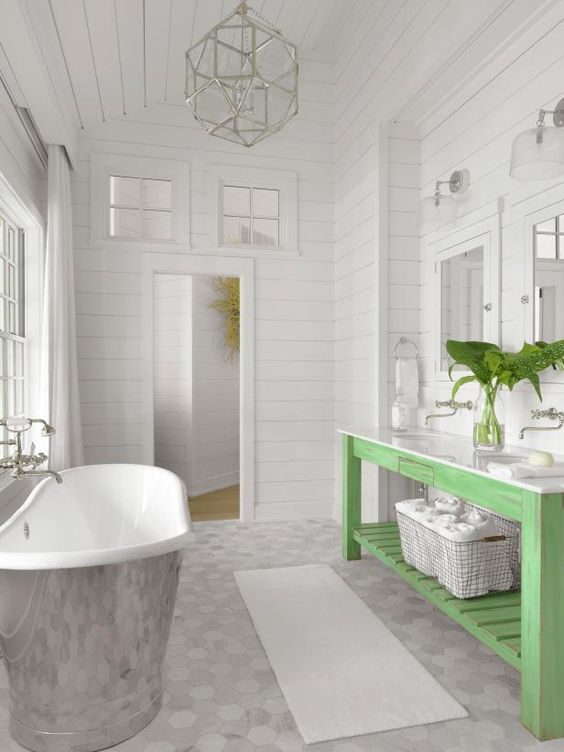 This bathroom is so pretty, what a perfect spot to finish the day …soaking in a gorgeous bathtub as you overlook the stars shining on the lake… and the distressed wood bathroom vanity adds a visual pop of color…