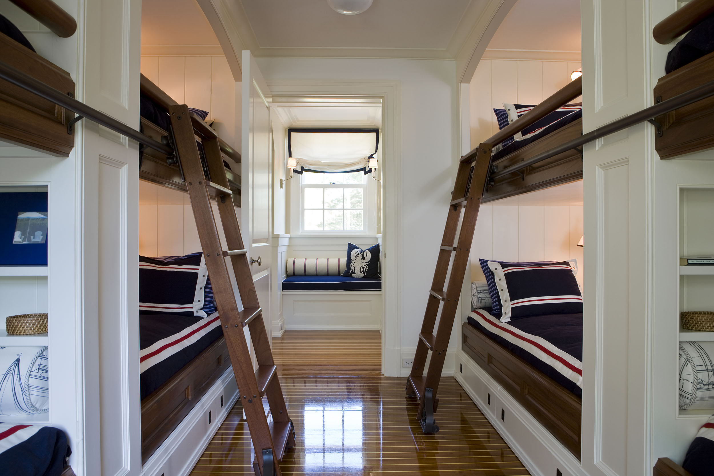 This bunk bed room looks like it is on a boat..the designer captured the nautical look to a tee.