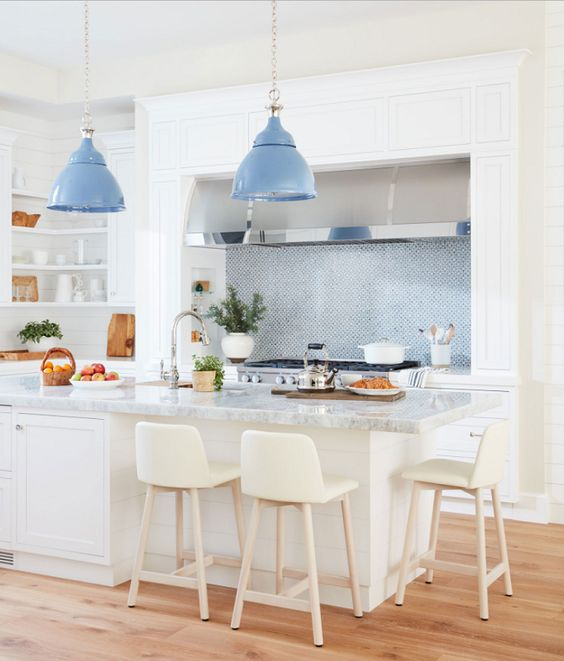 Add a beautiful shade of color with an eclectic pendant light above the kitchen island.  Via