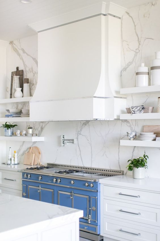 This Dramatic Blue Range, definitely has the WOW factor, and is a Dream Appliance for any Chef, and what a Conversation Piece.  Via