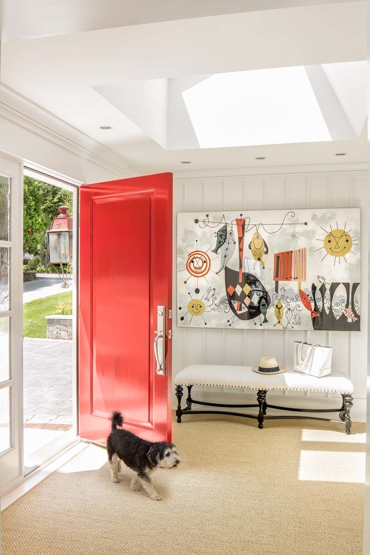 Adding a large piece of modern art to a classic style home..creates a stylish edge to a traditional home.