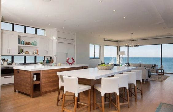 Perfection… a modern kitchen sporting clean lines and forward-thinking materials  via