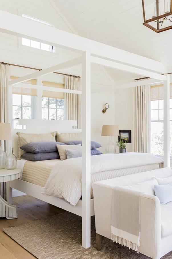 Formerly the garage, the new Master Suite includes sitting area, dressing hall and bath.  The custom Mariner canopy bed, from  Lisa Tharp Collection,  evokes large dock cleats.