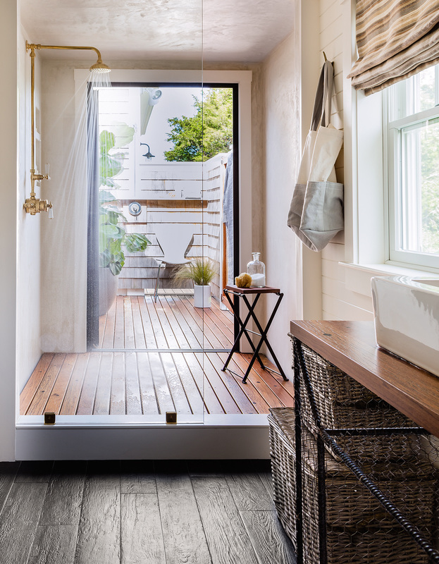 Lisa reworked the master bath layout to create connected indoor/outdoor showers — the ultimate luxury for communing with nature. Waterproof plaster clads the shower. Coney Island boardwalk planks have new life as vanity countertops and shower floors.