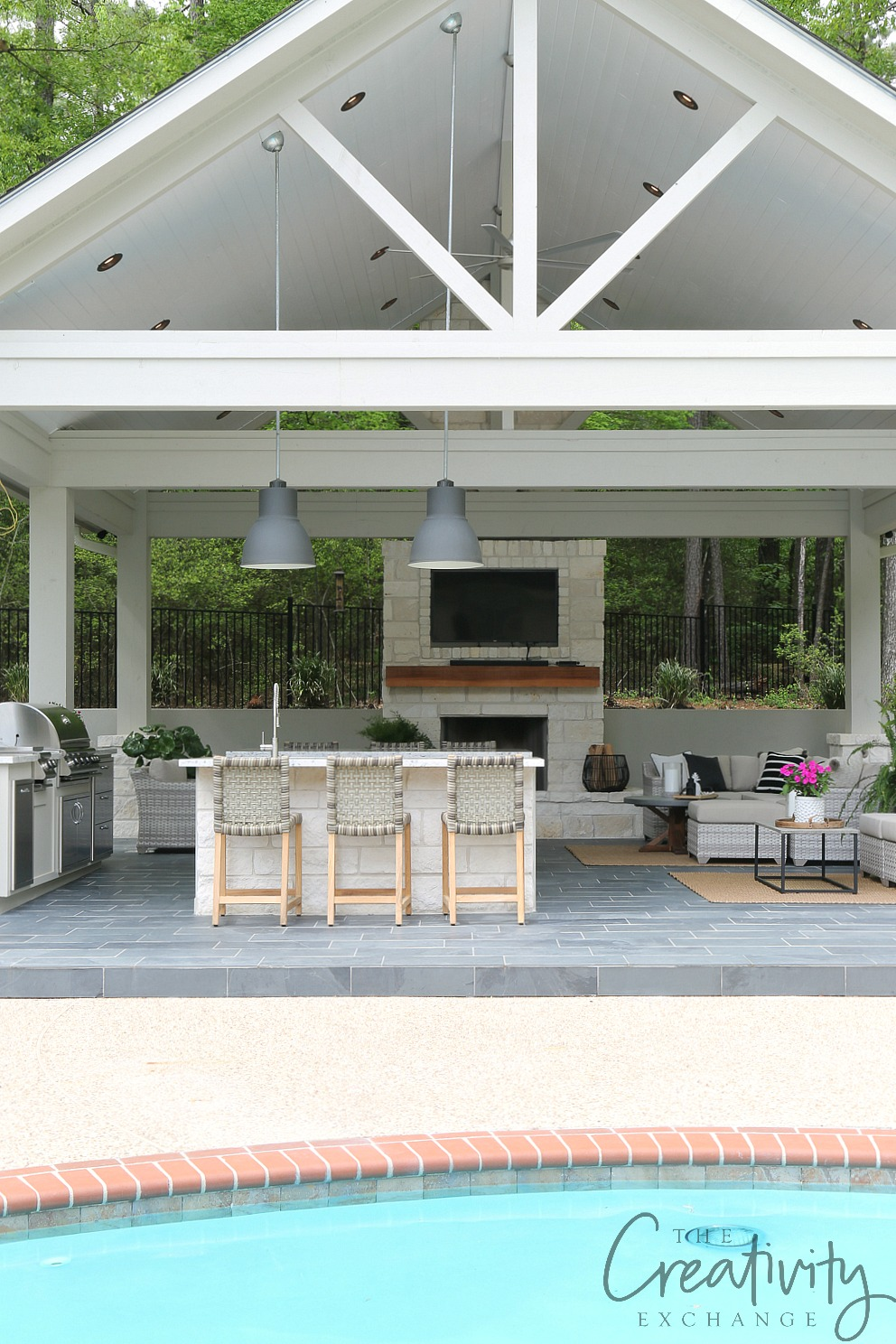 """The base of the pool house, bars and fireplace is limestone, she suggests """"only using the whitest side of the stone to keep things light and airy, because limestone can be orange-yellow from the iron."""""""