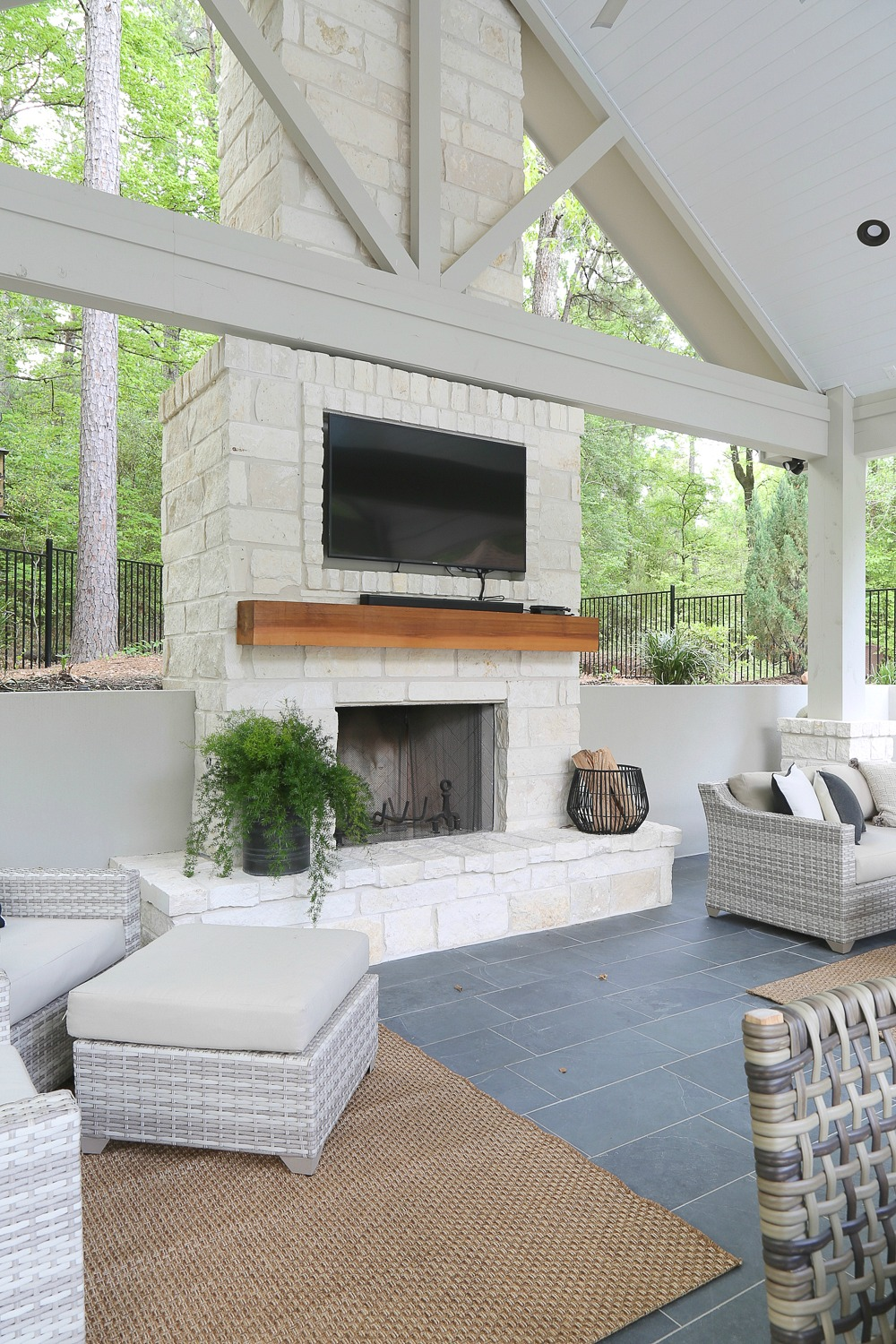 The wood on the fireplace is a solid cedar beam.