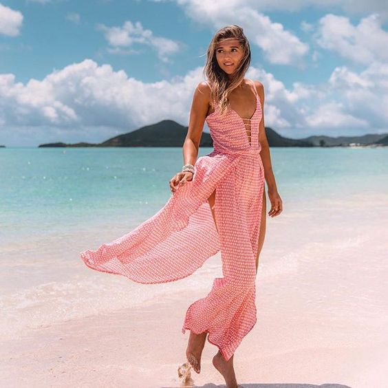 This pretty pink cover-up is such a breathe of fresh air…lightweight and lovely! | Shop this   designer  .