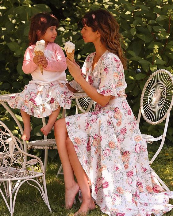 Wilder Fleur  , creator of   Mother Muse Mag    ,  enjoying her afternoon with her daughter wearing matching floral dresses | Shop this   designer  .