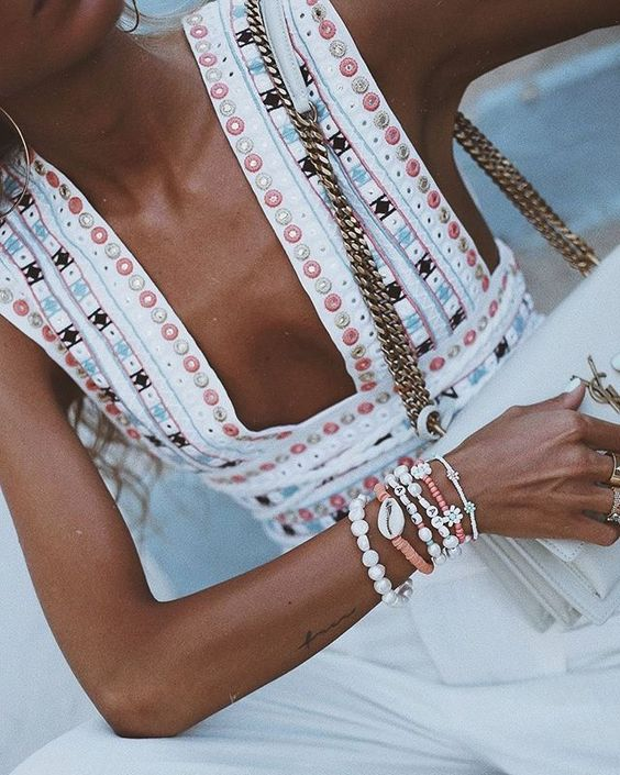 layered bracelets (x), gorgeous tan (x), stylish bag (x), and pretty outfit (x)-   Paula Arguelles   looks beach pretty: casual, chic + effortless| Shop this   designer  .