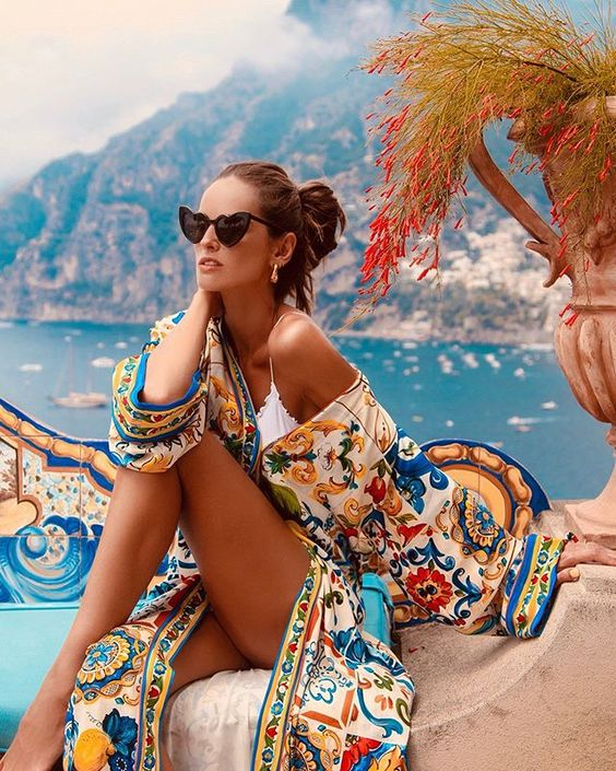 This colorful bright cover-up is spectacular on   Izabel Goulart   ….she looks like a Greek Goddess. Easy to achieve: Wear a solid one-piece, a pair of stunning over-sized sunglasses, earrings and a signature cover-up and you too can be Beach Pretty.
