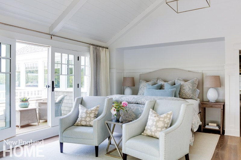 A master bedroom suite in a neutral color scheme with robin egg blue accents, added luxury is a your own private terrace to enjoy the tranquility and beauty of early mornings on the lake.