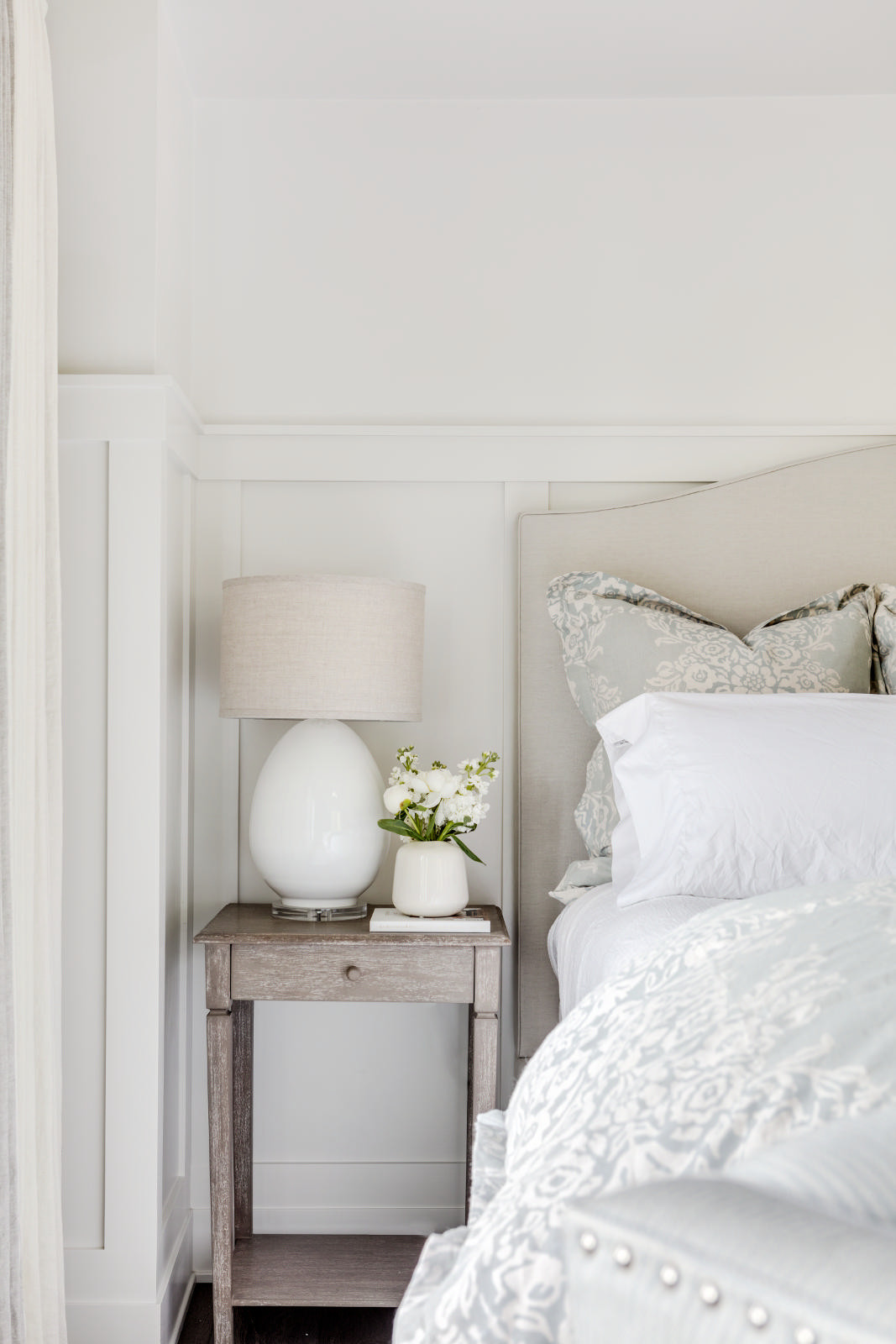 How pretty is the bedding and the sweet nightstand?