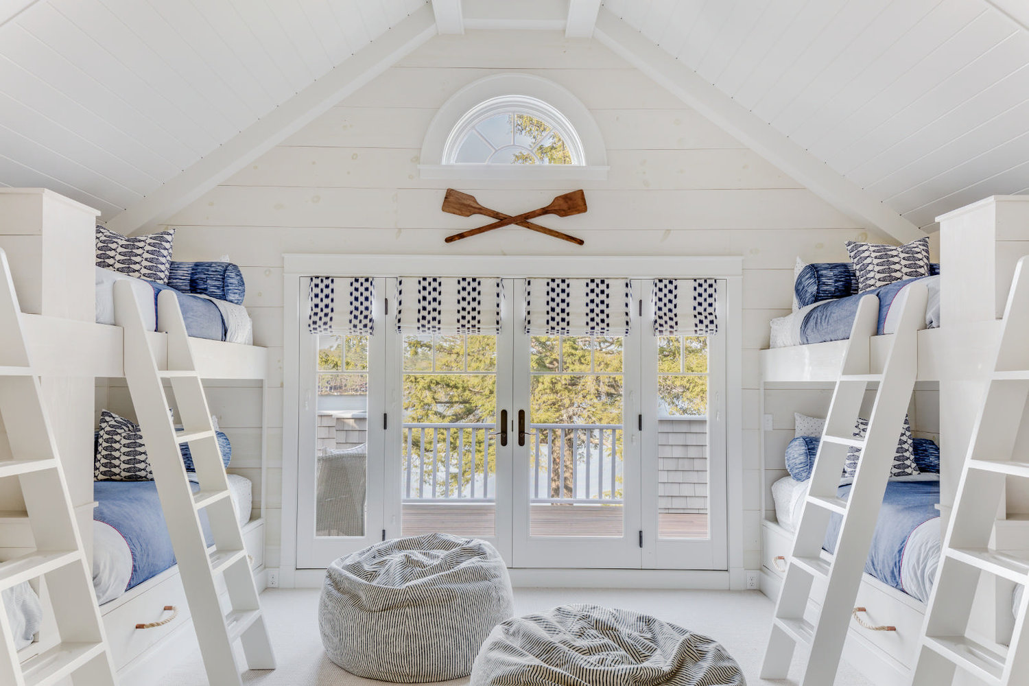 A cozy bunkroom that sleeps eight, how perfect is the coastal blue bedding the rope draw handles?