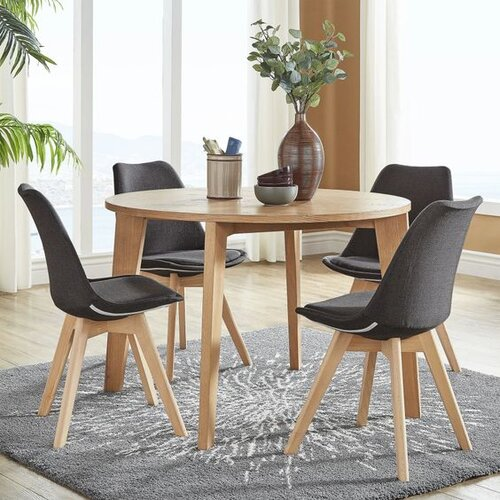 The table features glamorously tapered legs and a chic round table top to complement your existing decor. The chairs have a slightly contoured chair back for style and comfort as well as a variety of linen upholstery options. The clean lines and silhouette will compliment any contemporary or modern dining space.  Shop this look   here