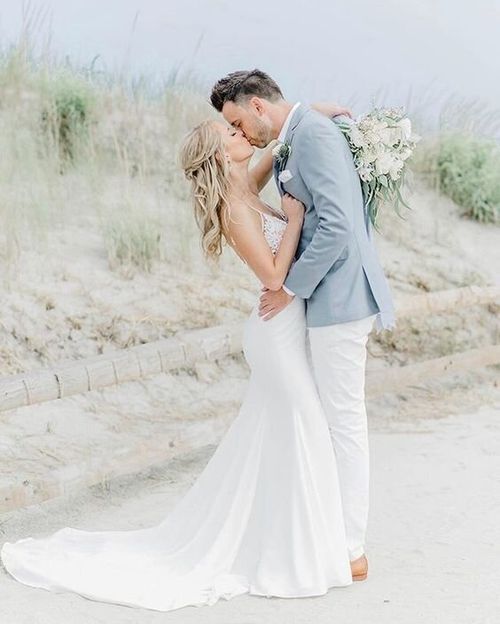 A hopeless romantic…and this couple looks so in love…and the setting is so beach pretty. Venue is the   Windrift Hotel Resort     and Photographer   Molly Sue Photography