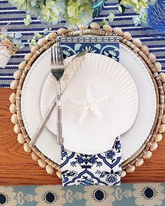 Coastal Blues…blue is a color you can use on your tablescapes all year round. I personally love to use blue accessories and linen with white dinnerware-this look is always crisp, classic and stunning.     via