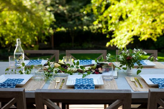 A casual dinner party for some of your close friends, a centerpiece of fresh cheese and fruits displayed on a white platter and greenery and individual posy of wildflowers. Simple but stunning. Featured on  Kimberlee Marie Interiors .