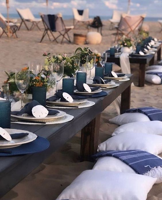 This beach setting is so what living by the coast is about, tiki torches and beach chairs, low tables with pillows in the sand and off course your toes in the sand. I can just imagine reggae or country music playing, as I watch the waves crash to the seashore.  via