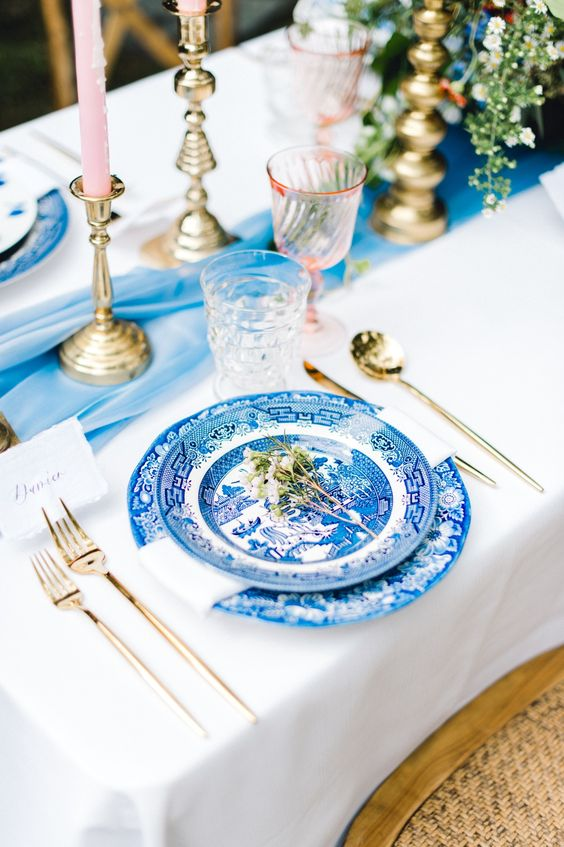A timeless classic fresh blue + white table with light pink accents is a beautifully set table anytime of the year.  via