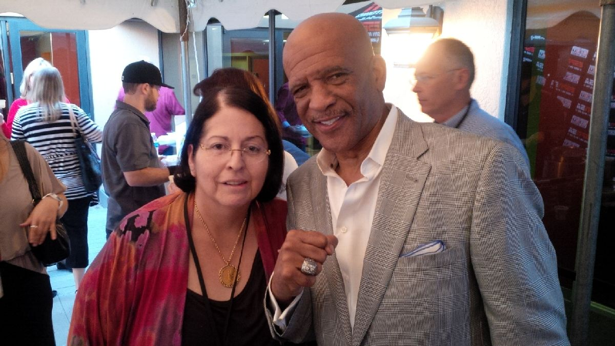 CPRA Vice President chatting up legendary Dallas Cowboys Wide Receiver Drew Pearson at ESPN gathering