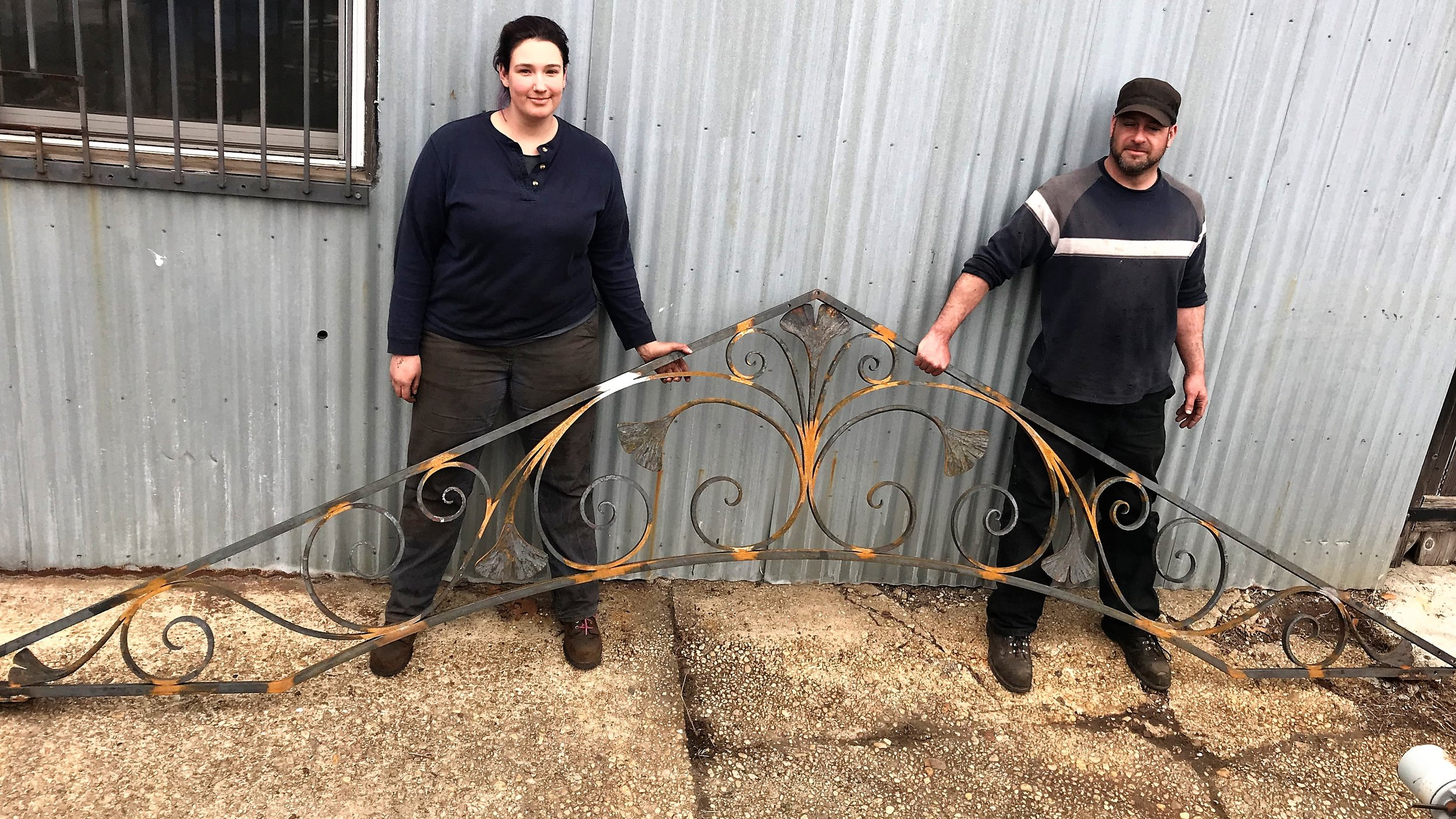 "This image shows two of our talented craftspeople with a finished truss.  This, along with the remaining pieces will be rust proofed and painted before final installation.  Please keep an eye out for the next blog in this series: ""Building a Custom Pergola-Part II of III: the fabrication process."