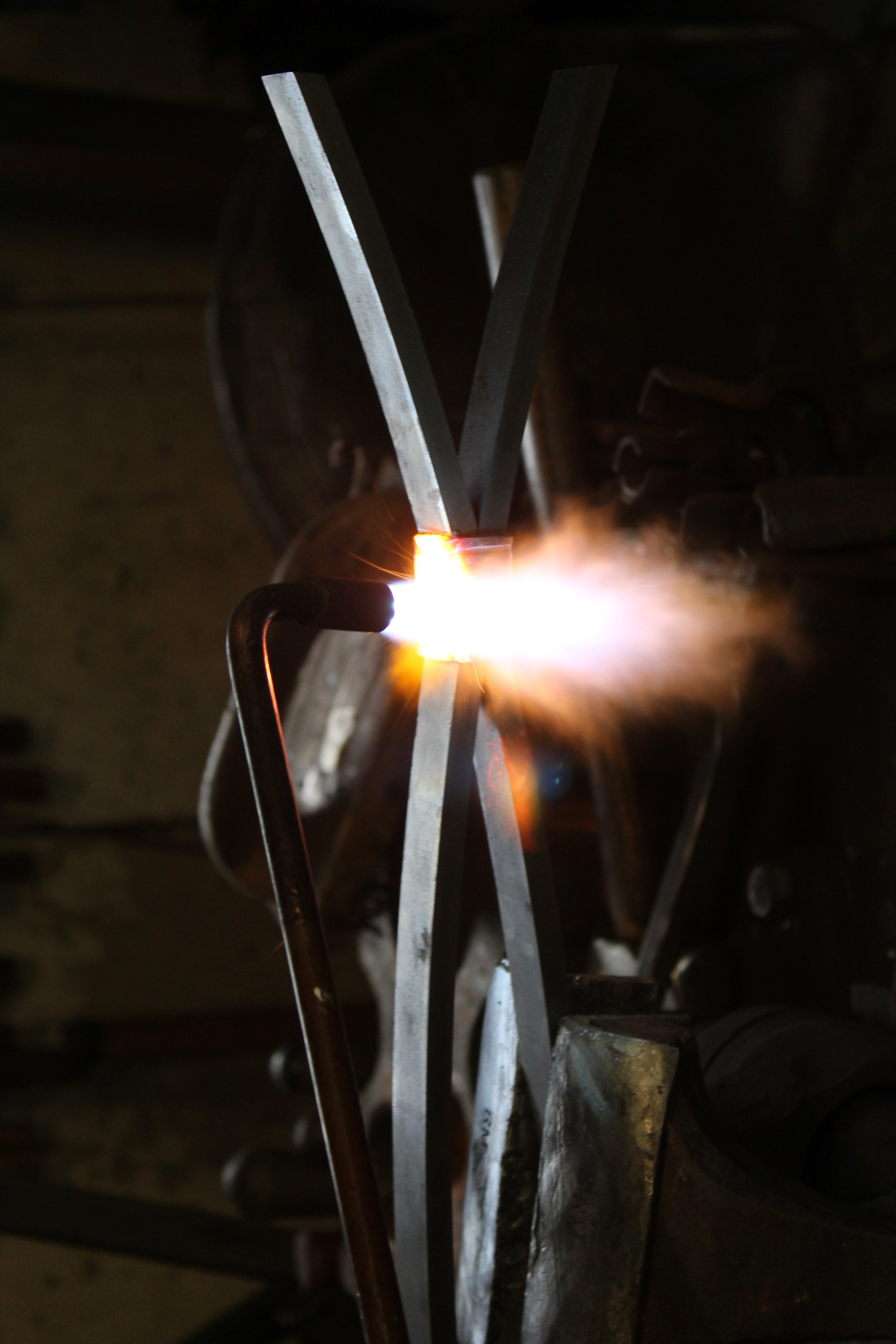 torch welding collars on infill.jpg