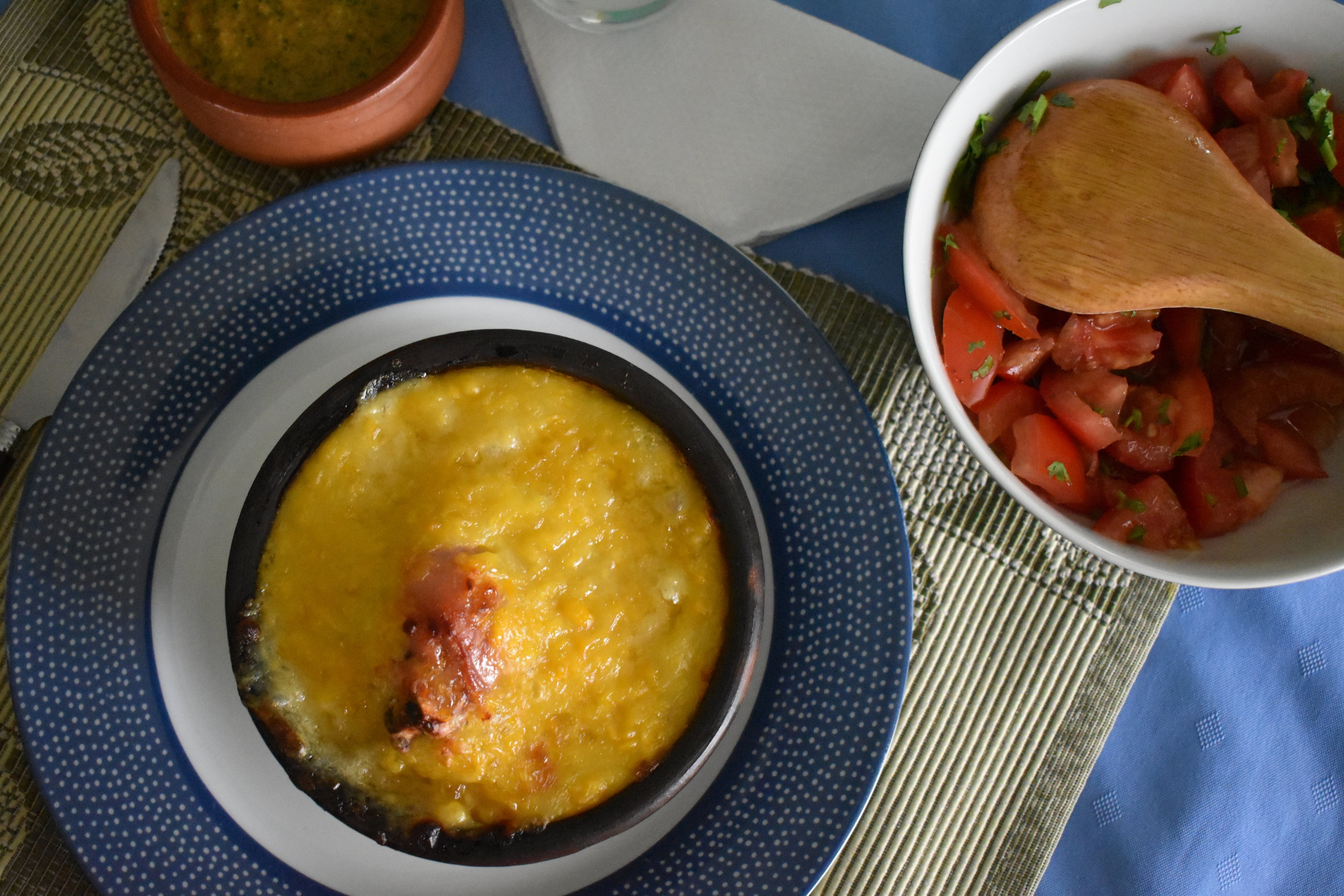 Pictured above, Pastel de Choclo and a side dish of tomato salad