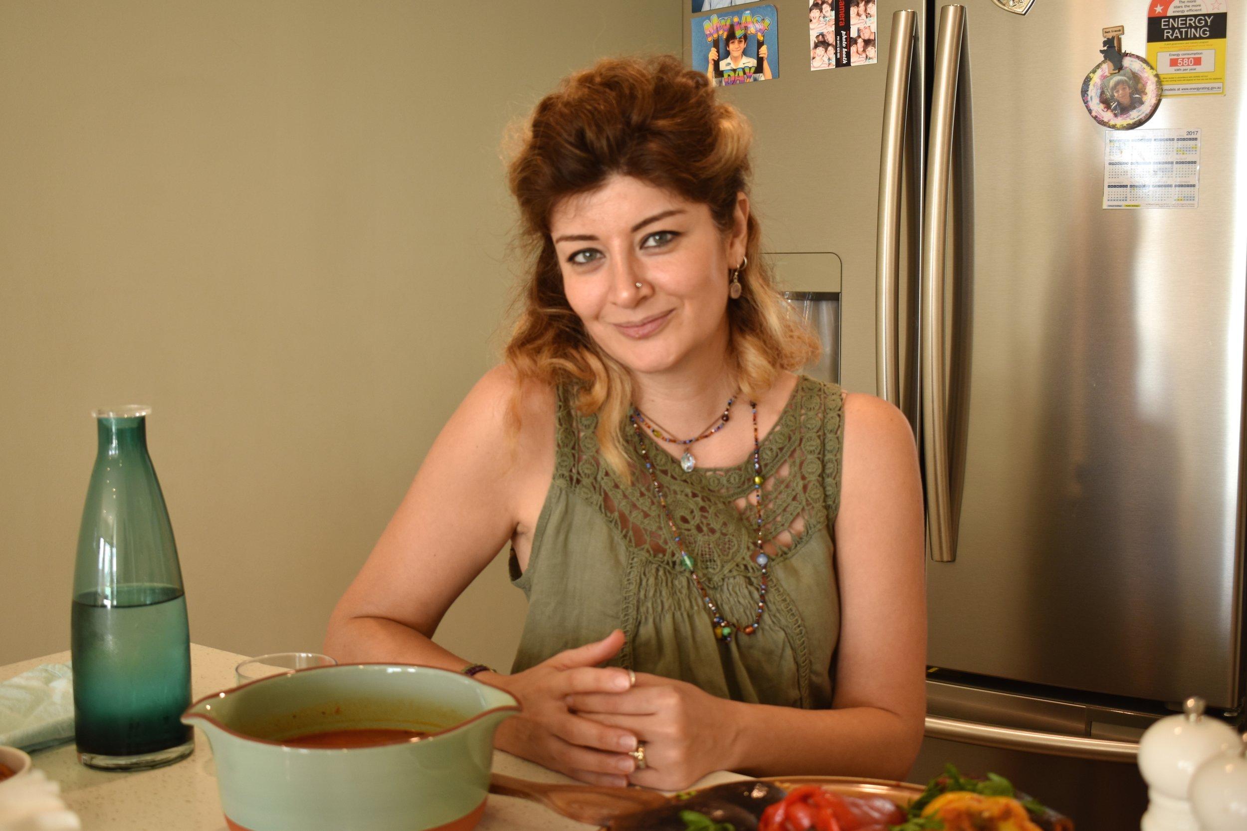 Nadia is seen here having a break in her kitchen