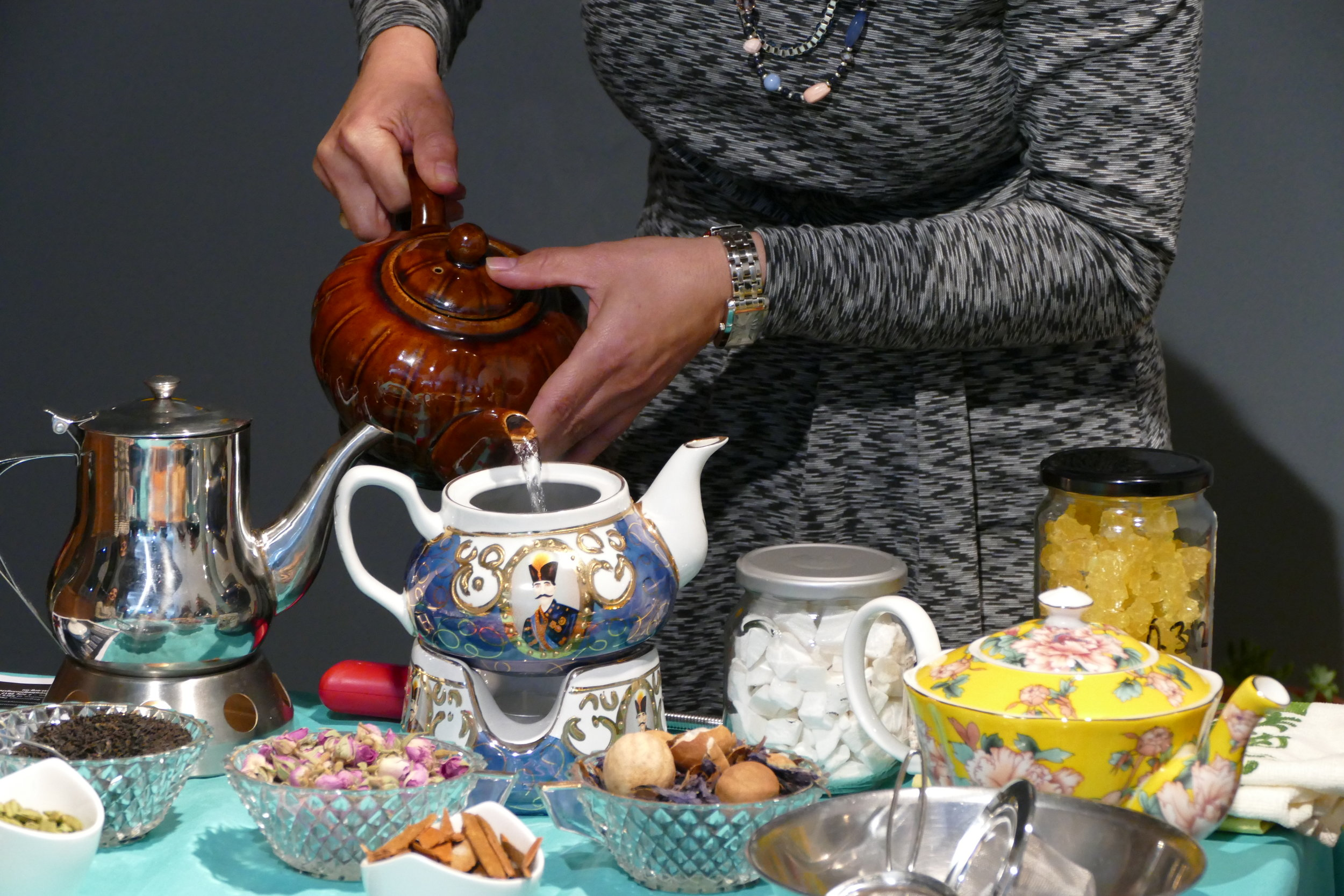 Ladan Haghighat pouring the tea for a booked-out Persian tea ceremony, organised by Community Kouzina as part of the New Beginnings Festival for Refugee Week.