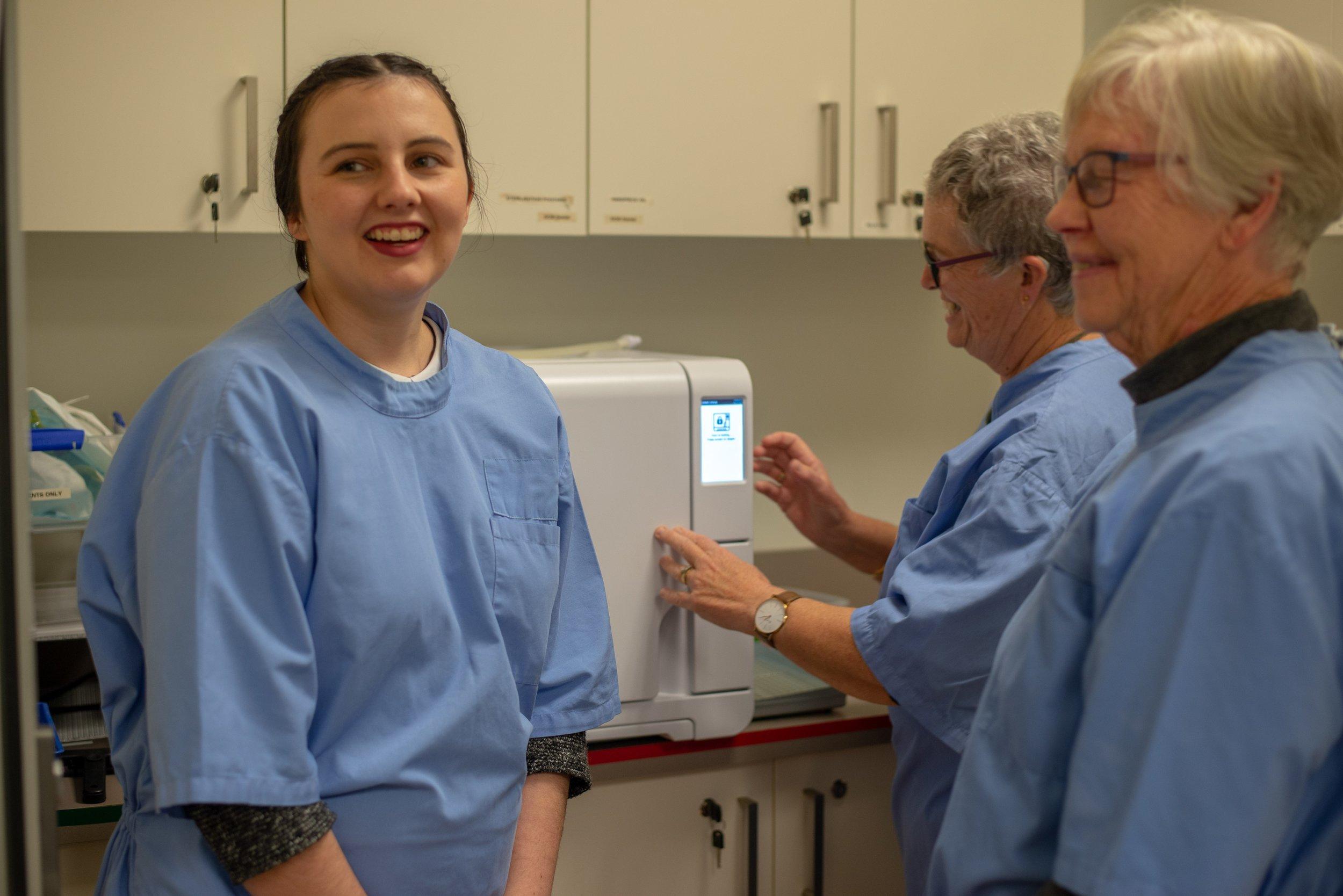 Dental assistant Emily Kremmer with other DCM volunteer DAs, Margaret and Marion
