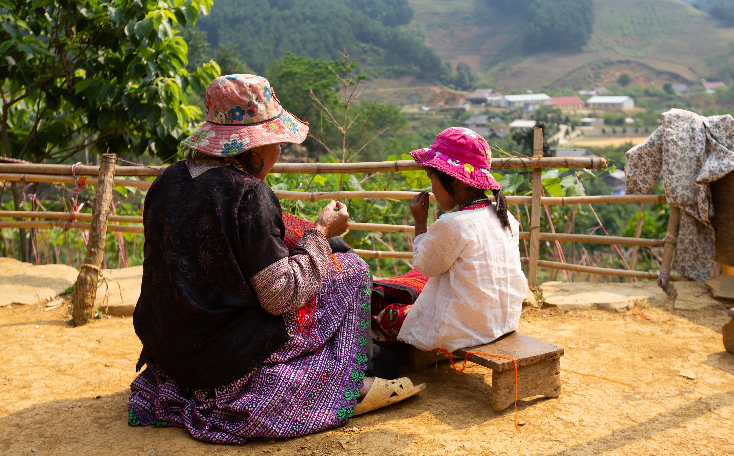 A mother teaching her daughter embroidery