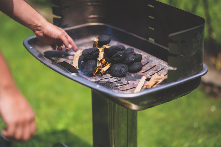 Fire up the grill and impress your guests! Photo via Pexels.