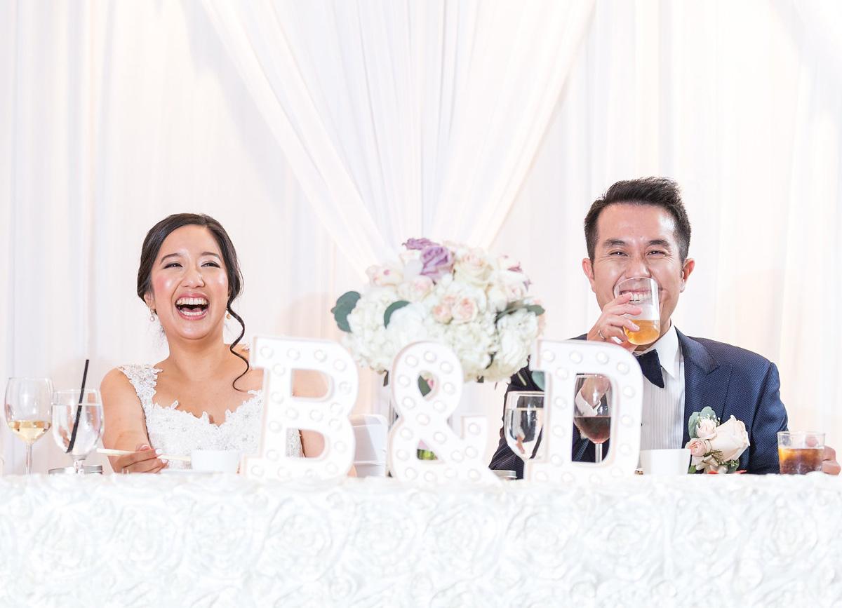 dloveaffair_wedding_reception_bride_groom_laugh.jpg