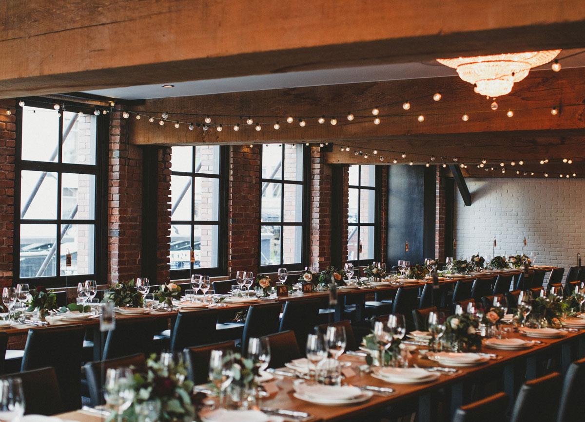 dloveaffair_wedding_reception_rustic_decor_brickwall.jpg
