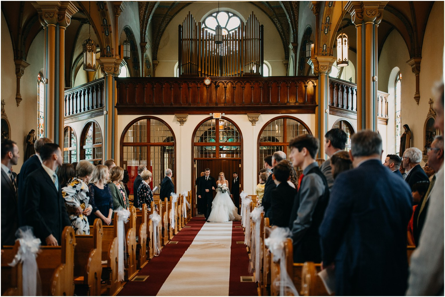 Bride Walking Down Isle at Catholic Church