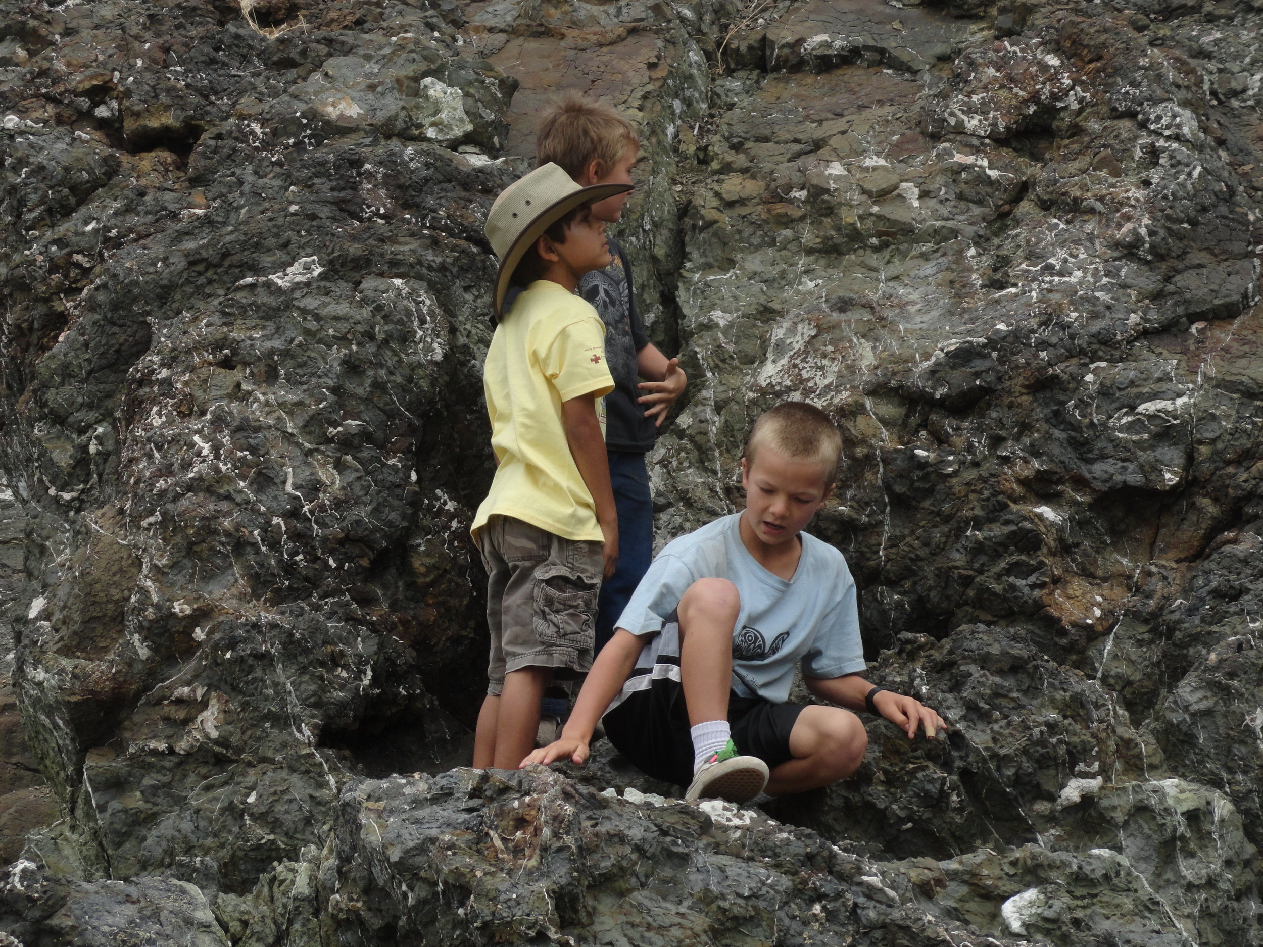 Examining pillow lava @ Port San Luis, students see the effects of underwater volcanic activity.