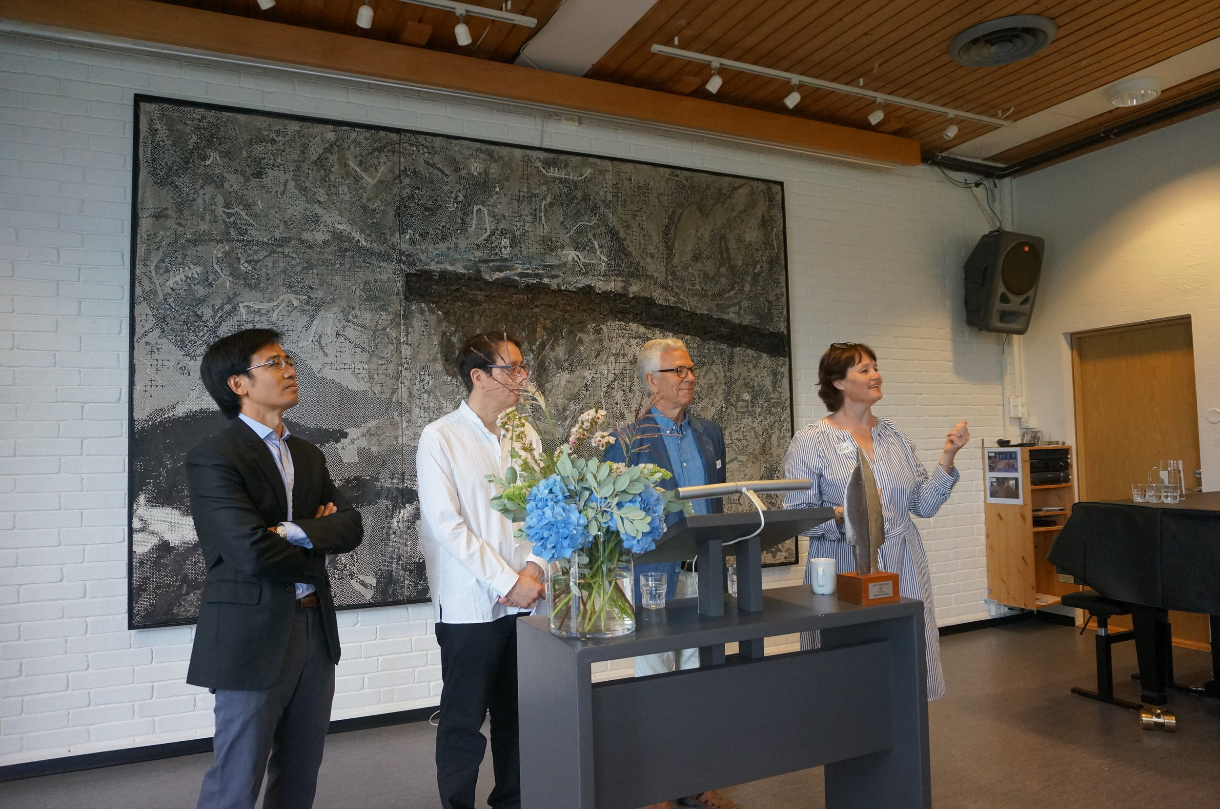 The organizers (Chunrong Liu, Daniel Bell, Geir Helgesen, and Unn Irene Aasdalen) welcoming students the first day of lectures