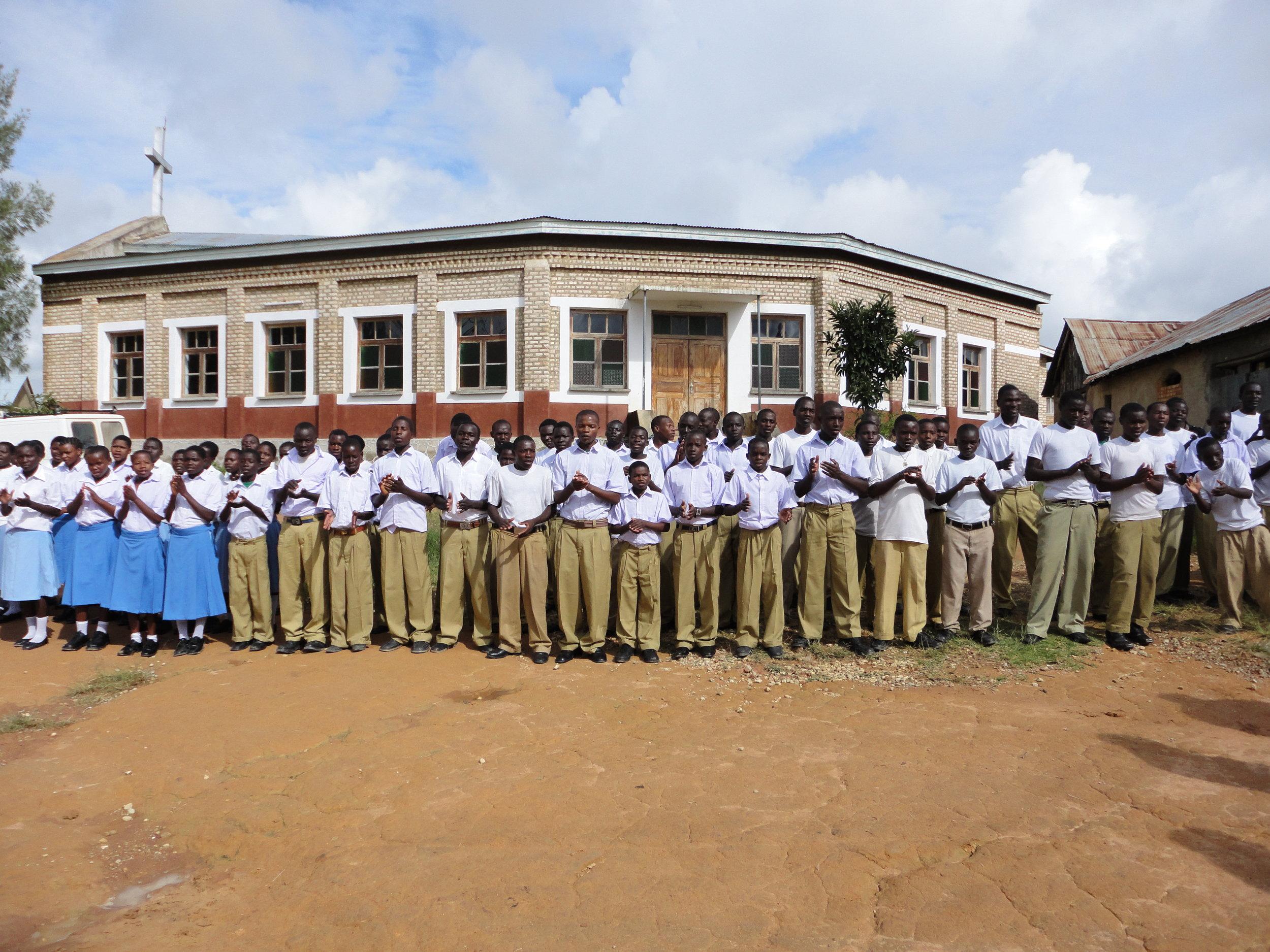 DSC00071 welcome from Ifunda VTC children.JPG