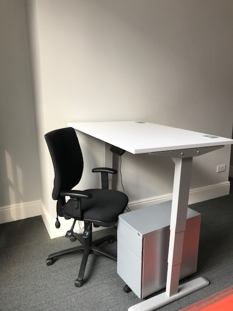 Electronically adjustable table in standing position