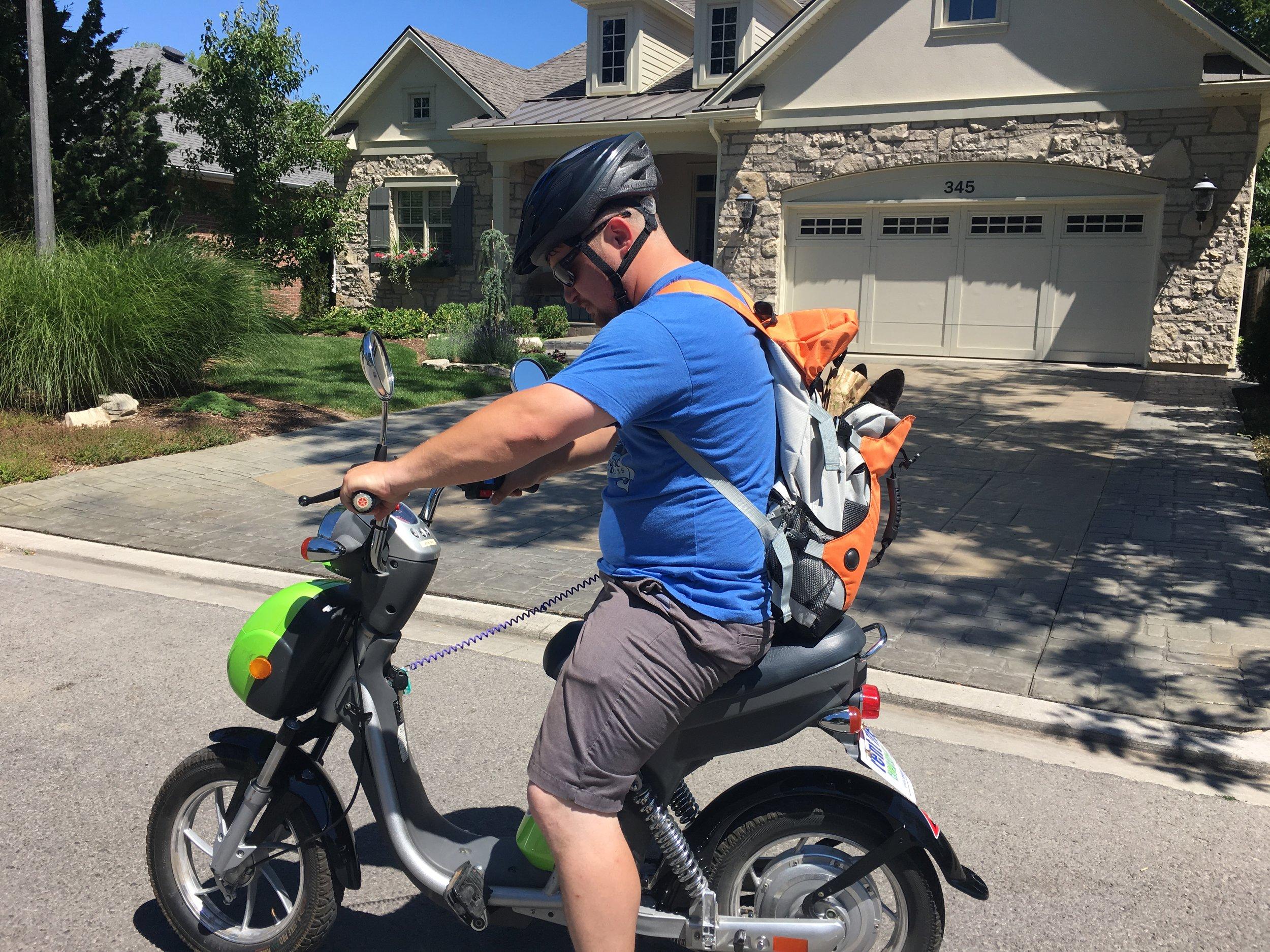 Mike e-skooting through the neighborhoods