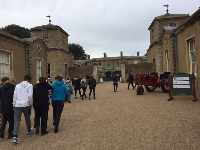 Walking into Holkham Hall