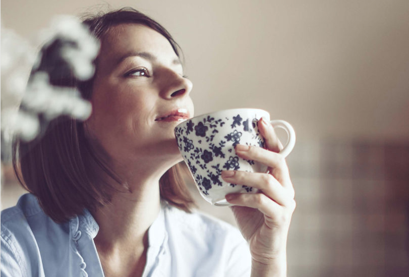 self-compassion, woman drinking from mug