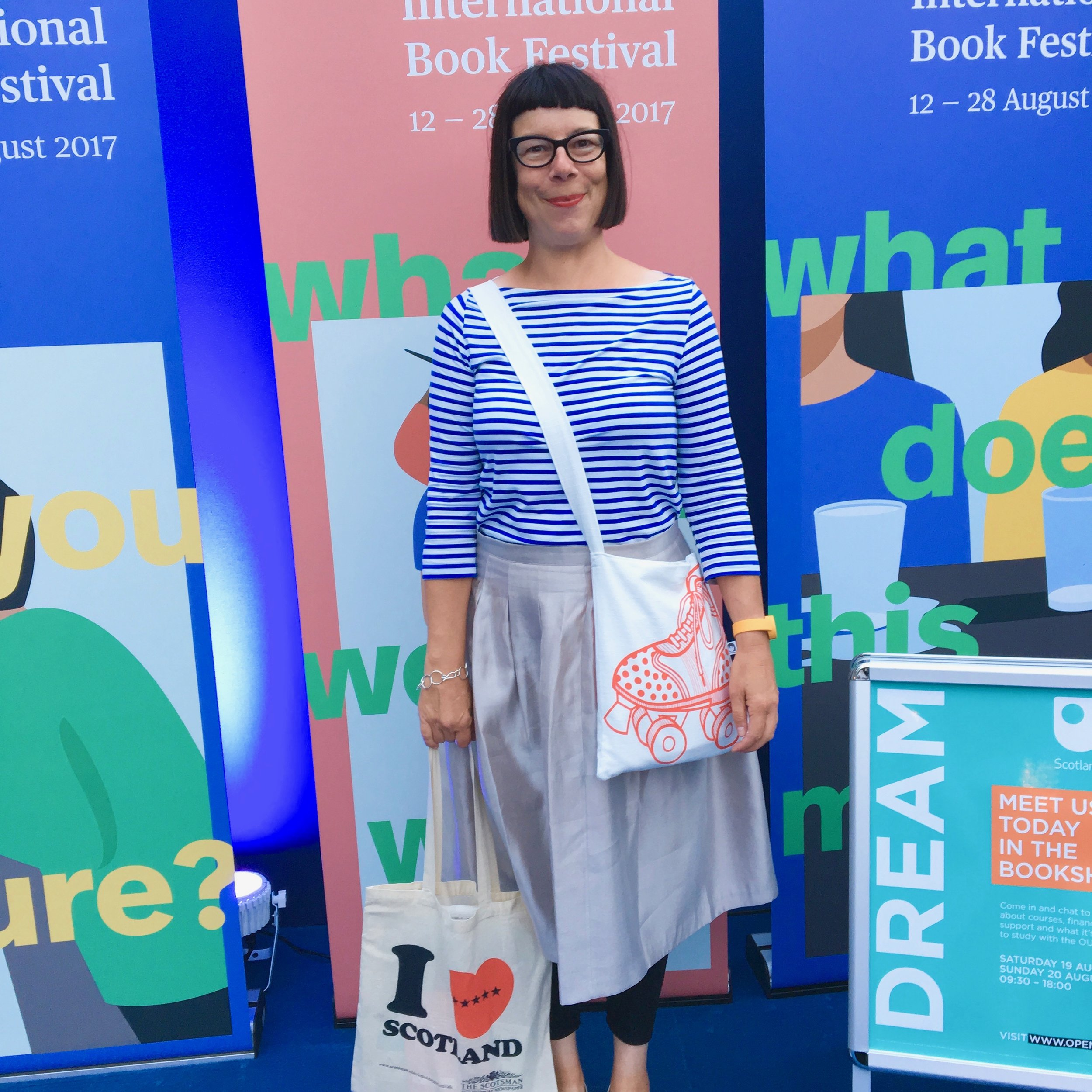 Standing in the entrance to the Edinburgh Book Festival