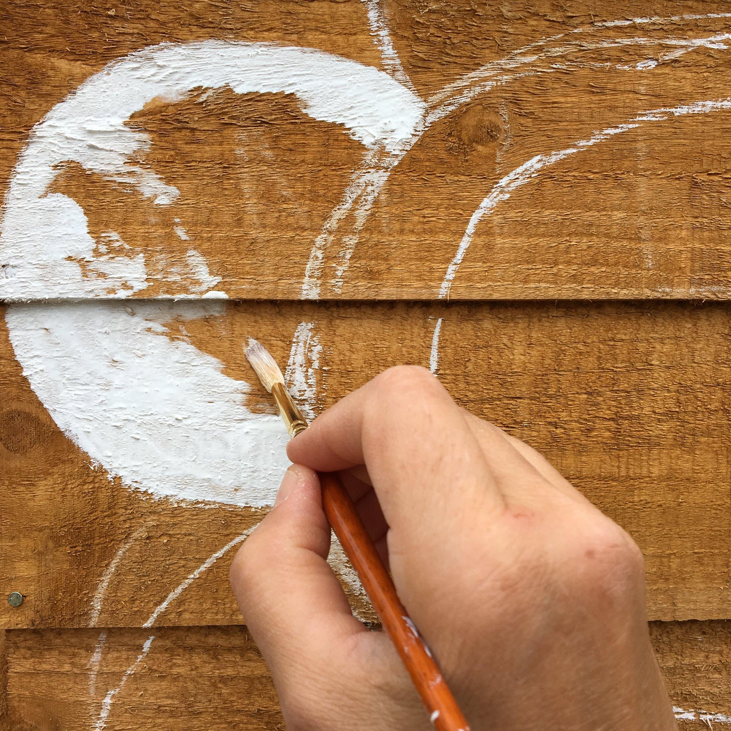 Painting the flower shape using Cuprinol's White Daisy shade of paint
