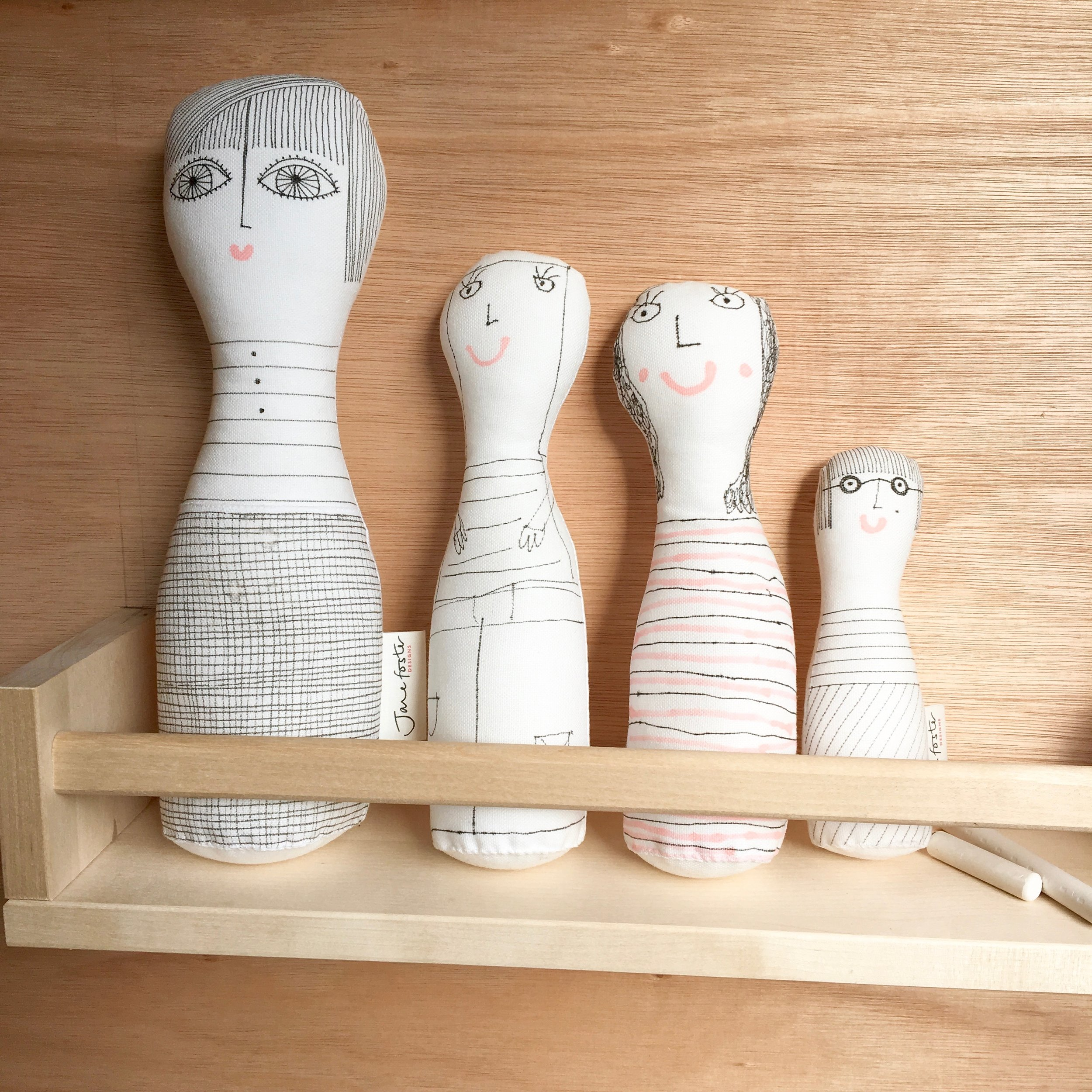 Hand illustrated fabric figures.