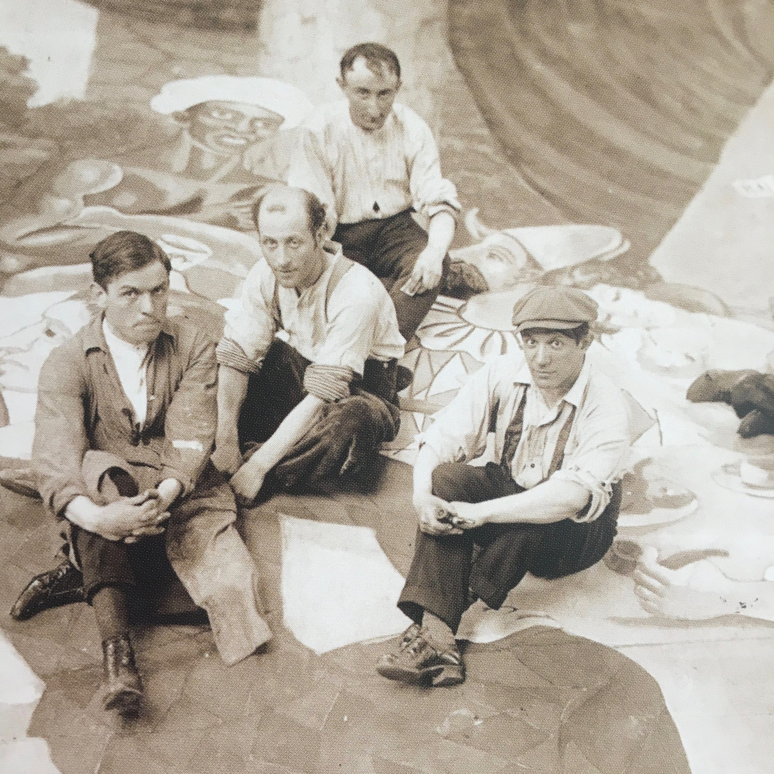 Picasso and his assistants sitting at work on the curtain of the ballet Parade in 1917